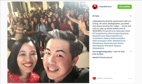 Lia Chang and Steve Jan SK-II National Brand Ambassador, take a selfie at the SK-II Pop-up Studio in New York on October 22, 2015.