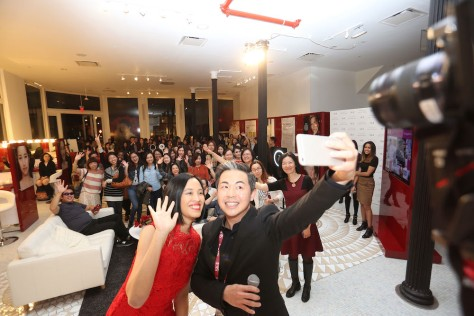 Lia Chang and Steve Jan SK-II National Brand Ambassador, take a selfie at the SK-II Pop-up Studio in New York on October 22, 2015. Photo: Elite Magazine