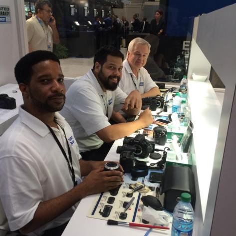 Tamron technicians Damion Fearron, Riccardo Rizzo and John Hermanson are waiting to clean and inspect your Tamron lens at booth #818 PDN's 2015 PhotoPlus International Conference + Expo at the Javits Center in New York. Photo by Lia Chang