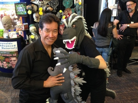 Peter Kwong and Baby Godzilla protected by Godzilla at Son of Monsterpalooza in Burbank on September 19, 2015.