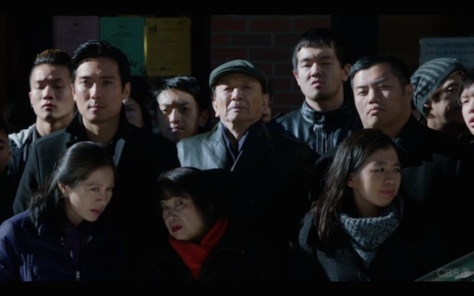 "James Hong (Center) in ""Elementary""."