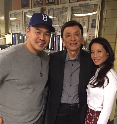 "Director Larry Teng, James Hong and Lucy Liu on the set of ""Elementary"". Photo courtesy of James Hong's Facebook Page"