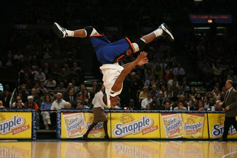 """Emmanuel """"Manny"""" Brown in flight as a Knicks Acroback Tumblers at Madison Square Garden. Photo: Facebook"""