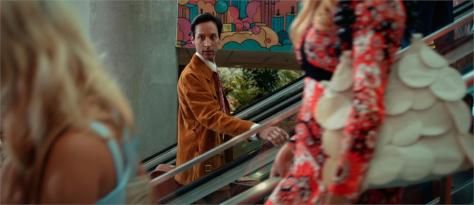Danny Pudi checks out the goods in a scene from the film THE TIGER HUNTER - directed by Lena Khan - the Festival's Opening Night and World Premiere. Photo courtesy of the Los Angeles Asian Pacific Film Festival