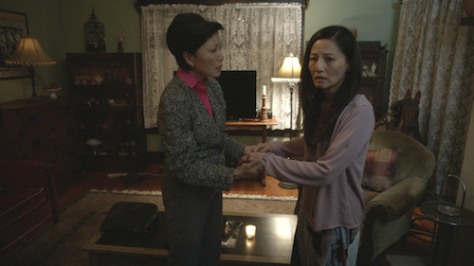 THE UNBIDDEN- Elizabeth Sung (Left) plays Anna comforting her best friend Lauren played by Tamlyn Tomita (Right).