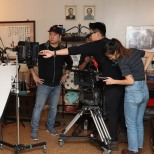 Director Chen Xi Hao with his camera crew. Photo by Lia Chang