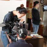 Assistant Camera operator Cindy Chen. Photo by Lia Chang
